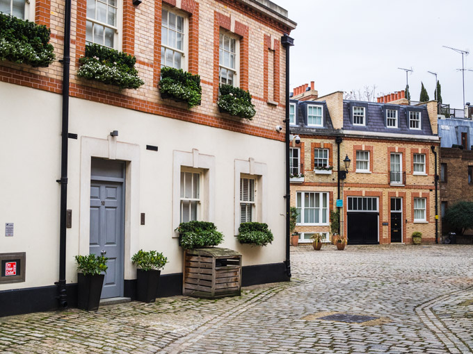 Row of mews houses and cobblestone street in Belgravia London