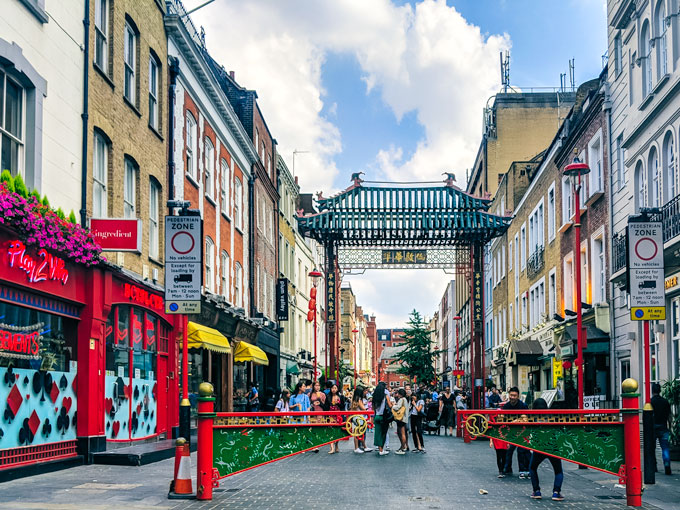 View of Chinese gate and restaurants near Leicester Square London