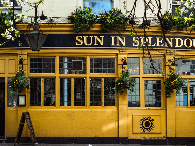 Yellow facade of Sun in Splendour pub in Notting Hill London