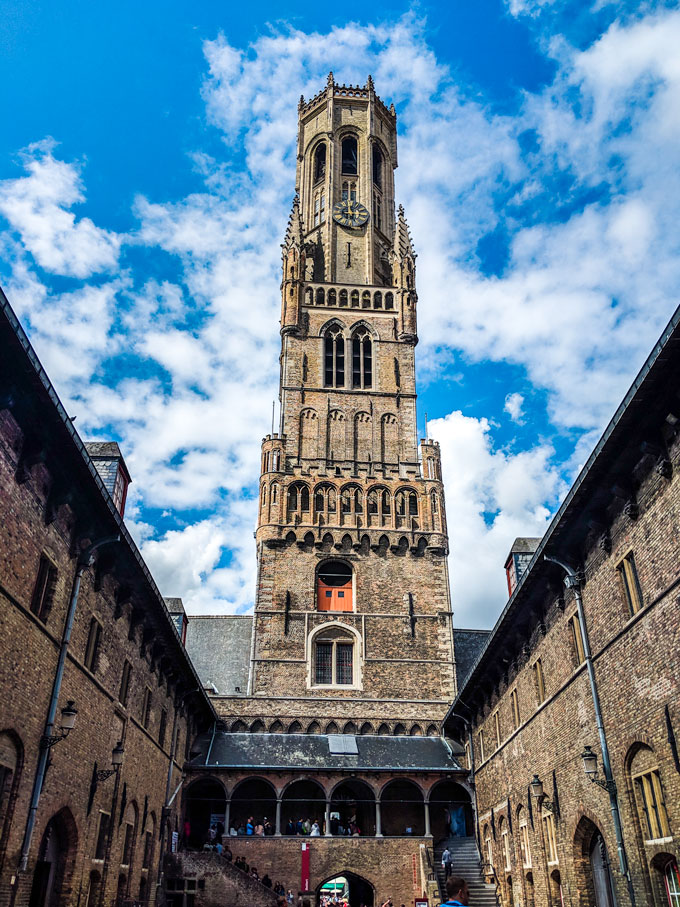 Walking towards Bruges belfry bell tower