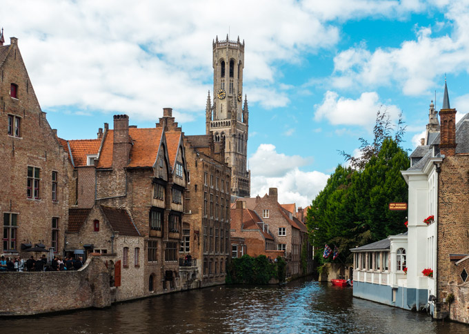 Bruges 1 day itinerary - view of old town with canal and belfry