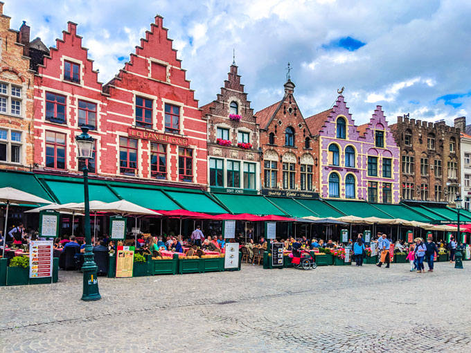 Colorful buildings in Bruges town square market