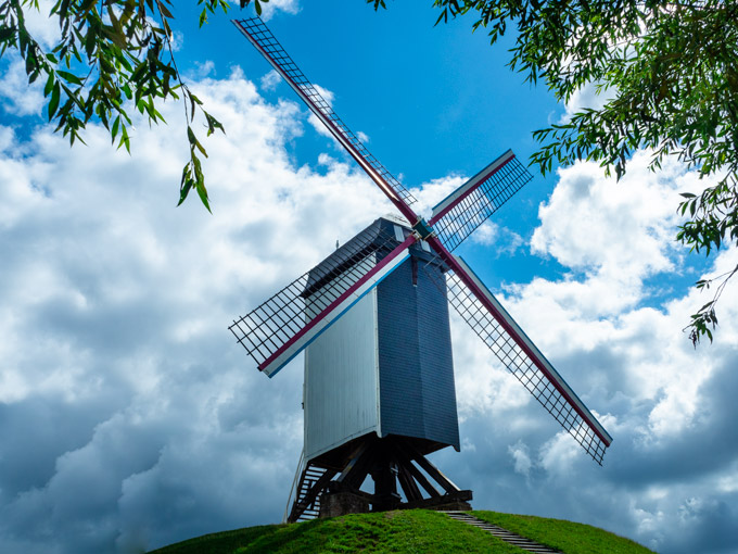 Sint Janhuis Windmill against cloudy sky in Bruges