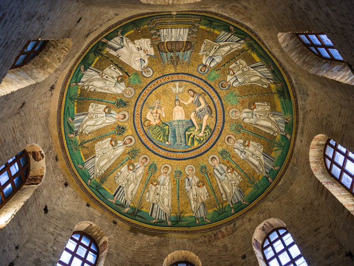 Windows and dome mosaic of Arian Baptistry in Ravenna depicting baptism of Jesus