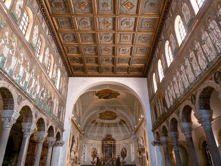 Ravenna Basilica di Sant'Apollinare Nuovo interior with blue and gold mosaics and ceiling