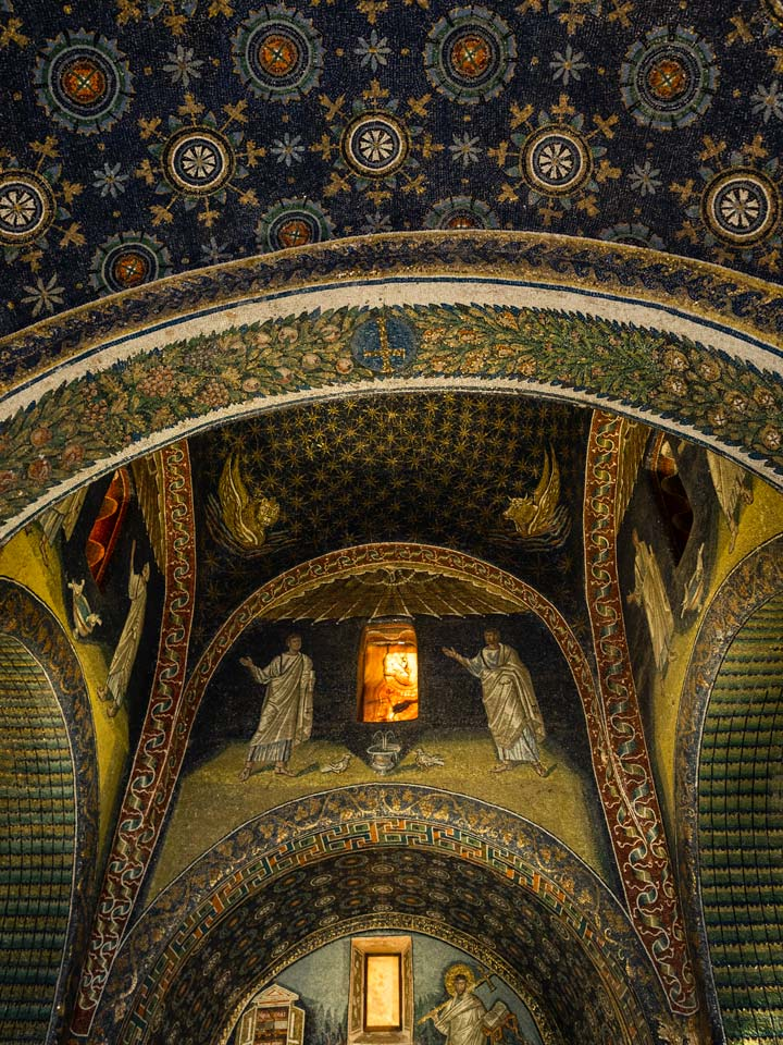 Mausoleo di Galla Placidia interior mosaic with blue and gold tiles and arched ceiling