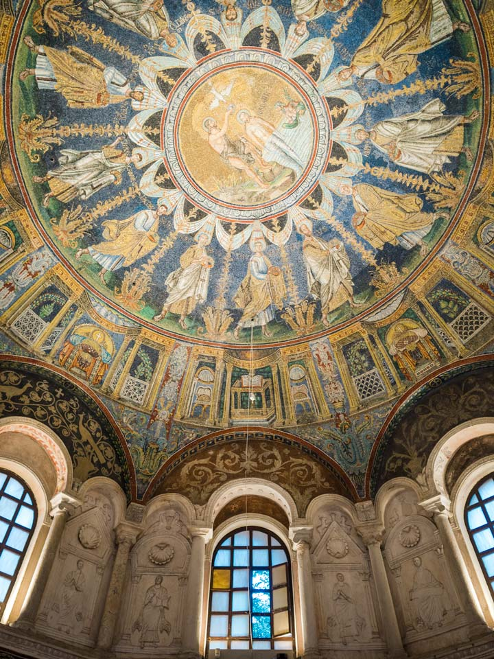Mosaic dome and windows of Baptistry of Neon, an essential stop on the Ravenna itinerary