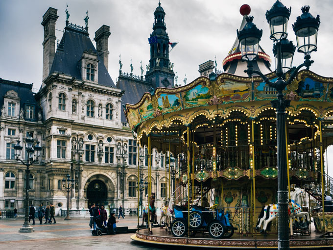 Hotel de Ville exterior with vintage carousel and lamp post in front