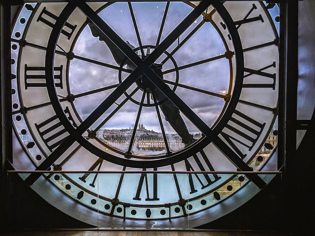 Paris itinerary: 4 days - Musee d'Orsay clock face with view of city skyline