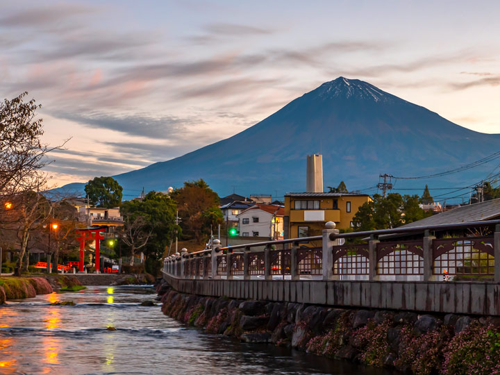 Fujinomiya town at blue hour with Mount Fuji in distance