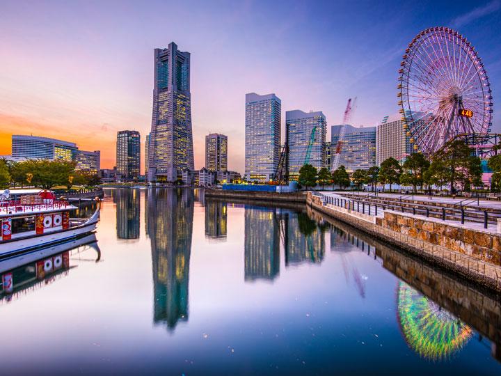 Yokohama Minato Mirai district with skyline and ferris wheel reflected in water