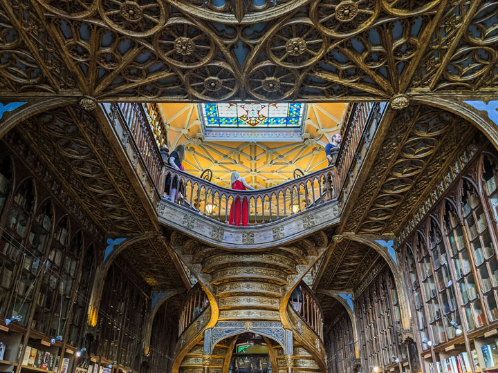 Interior of Livraria Lello staircase and bookshelves, a popular place to visit in Porto
