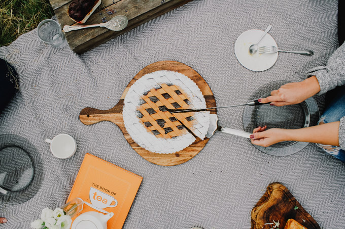 Having an outdoor picnic, a romantic staycation idea