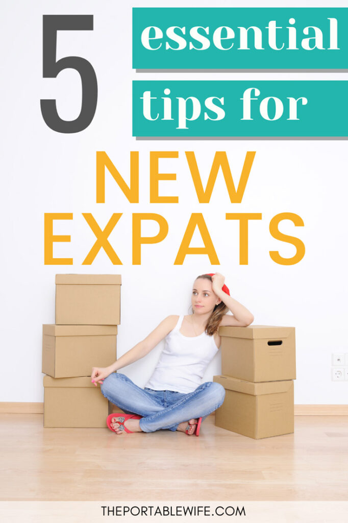 5 essential tips for new expats - girl sitting with boxes on floor