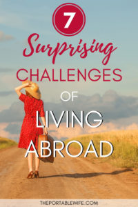 7 Surprising Challenges of Living Abroad - woman in red dress holding suitcase