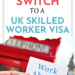 """Hand holding sign that says """"work abroad"""" in front of red telephone box, with text overlay - """"How to switch to a uk skilled worker visa""""."""