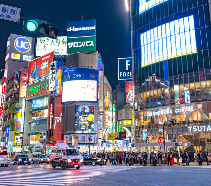 Shibuya Crossing at night, a must for any 6 day Tokyo itinerary
