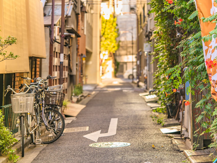 Typical Japan street with bikes seen when traveling Tokyo like a local