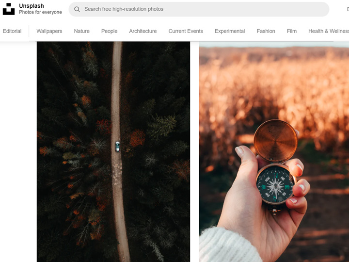 Screenshot of Unsplash website, with photos of car driving through forest and hand holding old metal compass