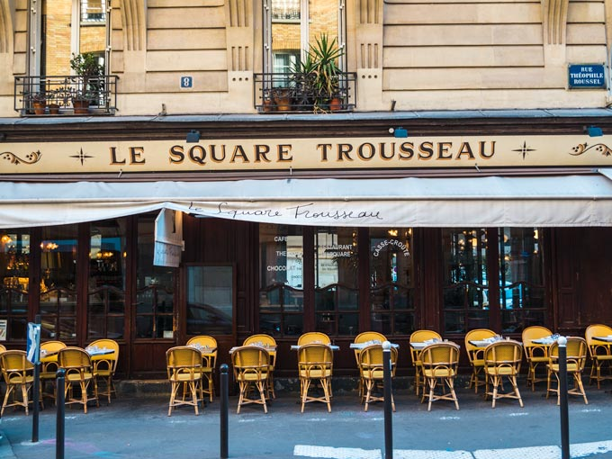Sidewalk cafe of Le Square Trousseau for typical French breakfast fare