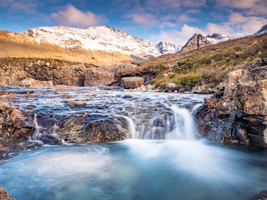 Water flowing into Isle of Skye's Fairy Pools, one of the top UK bucket list attractions.
