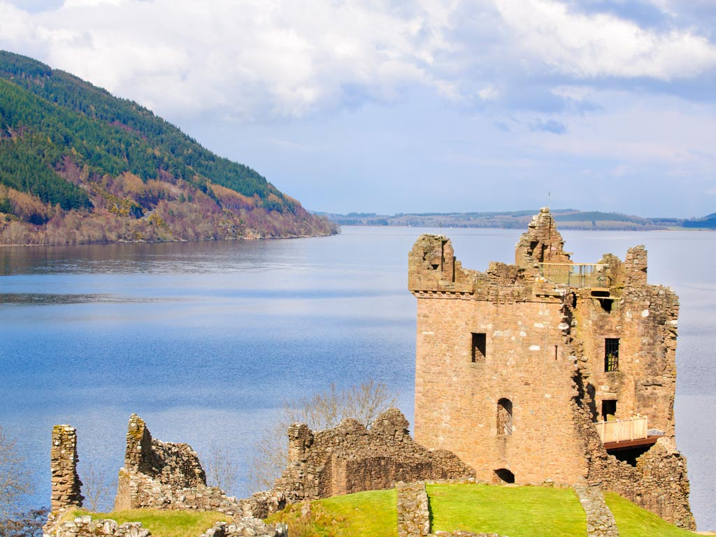 Partially ruined castle in front of Loch Ness.
