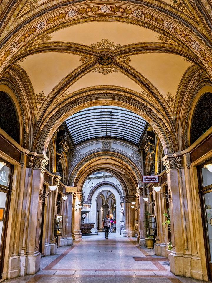 Vienna Ferstel Passage with golden arched ceiling and marble floor