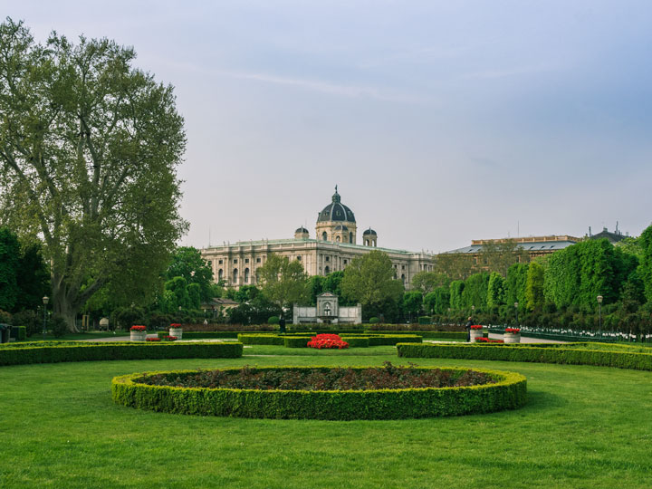 Green garden space and city view from Volksgarten, where to take a break during Vienna 2 day itinerary