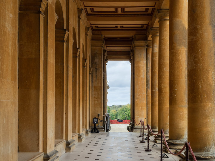 Yellow columned hallway leading to Blenheim Palace courtyard