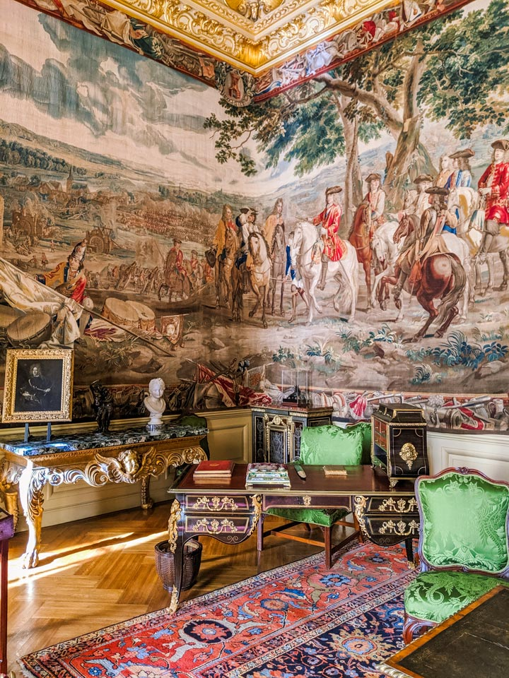 Blenheim Palace green drawing room with writing desk and painted fresco wall