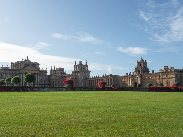 First view of residence during Blenheim Palace day trip with green lawn and blue sky