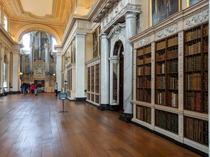 Blenheim Palace long library with white bookshelves and pipe organ