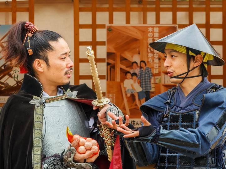 Two men in samurai costume performing at Nagoya Festival in Japan in October