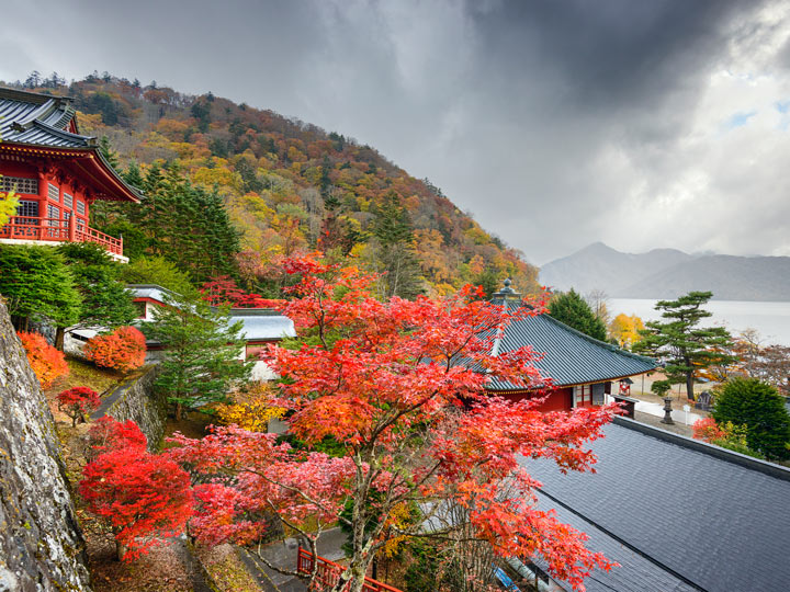Nikko shrine with view of lake and red Japanese maples